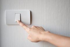 Giro inserita/disinserita sull'interruttore della luce Fotografia Stock