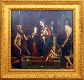 Girolamo da Carpi: Madonna i dziecko z świętym Jerome i John baptysta Zdjęcia Royalty Free