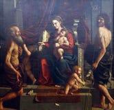 Girolamo da Carpi: Madonna i dziecko z świętym Jerome i John baptysta Zdjęcie Royalty Free