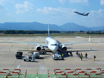 Girona Airport. Checking the plane and embarking passengers in Girona Costa Brava airport, Spain. The image is useful to describe the continuous influx of stock image