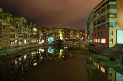 Girona. Night. Reflections. Colours. Houses. Water. Houses reflected on the river. Girona.Night Stock Photos