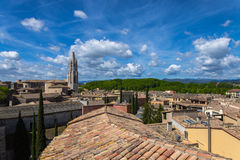 Girona old town view with green mountains and blue sky with clouds Royalty Free Stock Photo