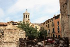 Girona, Spain, August 2018. A view from the Jewish quarter to a Catholic cathedral. Residential buildings of the area, built in the Middle Ages, are still in royalty free stock images