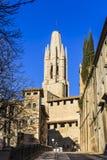 Bell tower of Collegiate Church of St. Felix from Pujada de Sant Feliu street stock photos