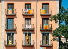Catalonia Independence Flags on balconies in Girona, Catolonia, Spain. Girona, Spain - July 10, 2018: Catalonia Independence Flags on balconies. The Catalan royalty free stock photography