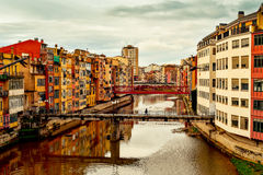 Girona, in Spain, and Onyar River. A view of the Onyar River as it passes through Girona, in Spain, some of its characteristics colorful houses and bridges stock photography