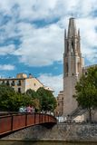 Collegiate Church of Sant Felix and bridge across the Onyar River, as seen from the street, Girona, Spain stock images