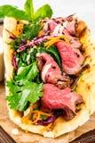 Giros com carne, vegetais e ervas fotografia de stock