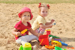 Girs in sand Royalty Free Stock Photography