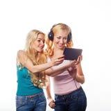 Girsl with headphones Stock Images