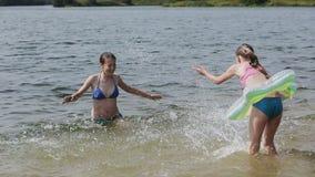 Girsl splashing in the lake stock footage