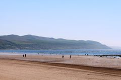 Girvan (Gharbhain) beach, Carrick, South Ayrshire. View south west over Girvan (Gharbhain) beach and across the side of the Firth of Clyde to the Carrick Hills royalty free stock photos