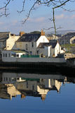 Girvan Harbour. Scotland, with reflections of buildings in the sea Stock Image