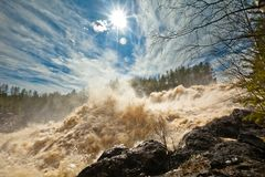 At the waterfall Girvas, Karelia. Spillway from hydroelectric power station. Girvas eruptive crater in Karelia, Russia. Flecks of sunlight. Sunny day in May Stock Images