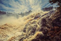 At the waterfall Girvas, Karelia. Sunny day in May. Girvas eruptive crater in Karelia, Russia.  Spillway from hydroelectric power station. Water foam and Royalty Free Stock Image