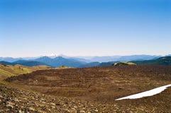 Gisements de lave avec la neige, Chili Photographie stock libre de droits