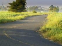 Gisements et lever de soleil de route Photo libre de droits