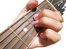 Gitaarovereenstemming, meisje het spelen gitaar Stock Foto's