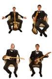 Gitarist in kostuum Royalty-vrije Stock Afbeelding