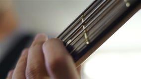 Gitarist Playing On Electrical Bass Guitar stock videobeelden
