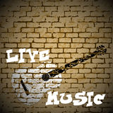 Gitarr för levande musik på en tegelstenbakgrund Royaltyfri Fotografi