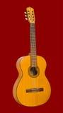 Gitarr på en röd bakgrund Royaltyfria Bilder