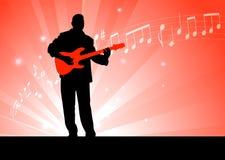 Gitarren-Spieler auf rotem Hintergrund Lizenzfreie Stockfotos