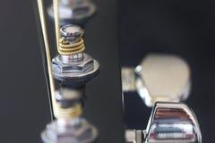 Gitarrentuner mit goldener Schnur Lizenzfreie Stockbilder