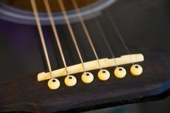 Gitarrenzeichenketten. Lizenzfreie Stockfotografie