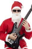 Gitarrist med den Santa Claus dräkten arkivfoton