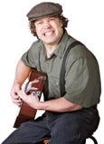 Gitarrist med grep hård om tänder royaltyfria foton