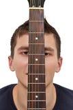 Gitarrist- och gitarrfretboard royaltyfria bilder
