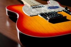 Gitarrsunburst i solljus Arkivfoton