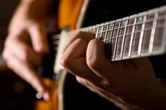 gitary bawić się Zdjęcie Stock
