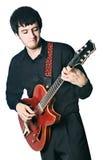 gitary elektrycznej gitarzysta odizolowywam bawić się Zdjęcia Royalty Free