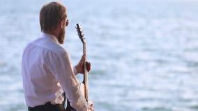 Gitarzysta bawić się w słońce kierunek i spojrzenia zbiory