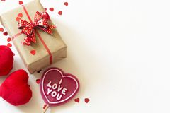 Gitf box with red hearts on wooden table. Space fot text. Royalty Free Stock Photo