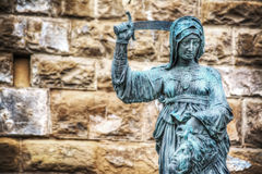 Giuditta and Oloferne bronze statue in Piazza della Signoria. Close up of  Giuditta and Oloferne bronze statue in Piazza della Signoria in Florence, Italy Stock Images
