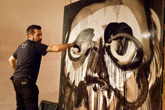 Giulio Masieri, draws a face during his performance Stock Photo