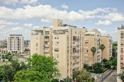 The Givat Nof district with the 50 years old 8 story apartment buildings. Ness Ziona, Israel-May 21, 2017: Three 50 years old 8 story buildings stand in a row royalty free stock photo