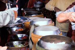 Give alms. To offer food to the monks stock image