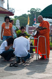 Give alms to a Buddhist monk 03. Wat Benchamabophit, Bangkok, Thailand - May 17, 2011 - Thai people give alms to a old Buddhist monk at  Wat Benchamabophit on Stock Image
