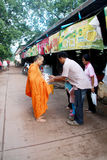 Give alms to a Buddhist monk Royalty Free Stock Photos