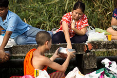 Give alms to a Buddhist monk Royalty Free Stock Photography