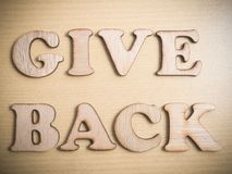 Give Back Motivational Words Quotes Concept. Give Back in wooden words letter, motivational self development business typography quotes concept royalty free stock photo