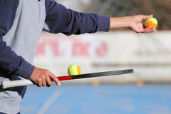 Give the ball. The instructor with the bat and ball to a tennis lesson Royalty Free Stock Photography