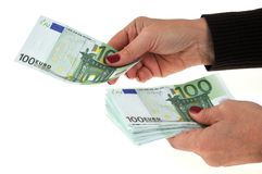 Give a banknote of one hundred euros stock photography