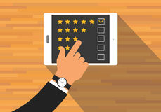 Give feedback rating. Use tab or digital device Stock Photo