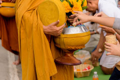 Give food alms to monk. Give food alms to a buddhist monk Stock Images