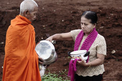 Give food offerings to a Buddhist monk Royalty Free Stock Images